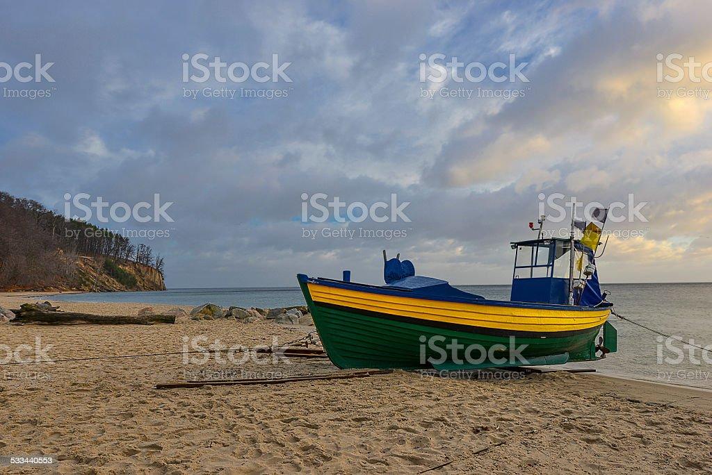 Fishing boat on the beach stock photo