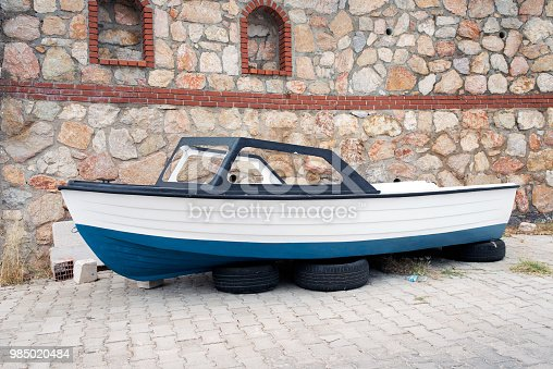 A fishing boat on the car wheels in the street in Bodrum, Turkey
