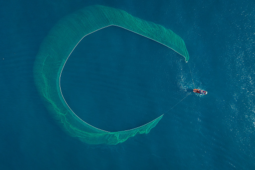 Drone view of fishing boat on the sea, looks like wings of the boat