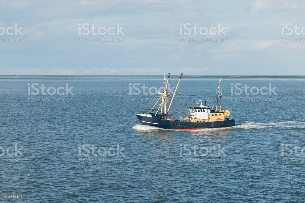 Fishing boat on the Wadden Sea . stock photo