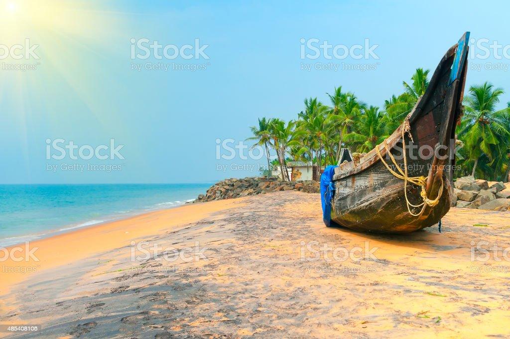 Fishing  Boat on Tropical beach stock photo