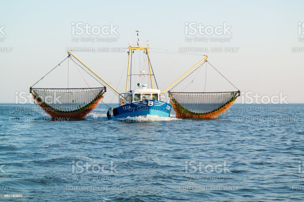 Fishing boat or shrimp trawler fishing on Waddensea, Netherlands stock photo
