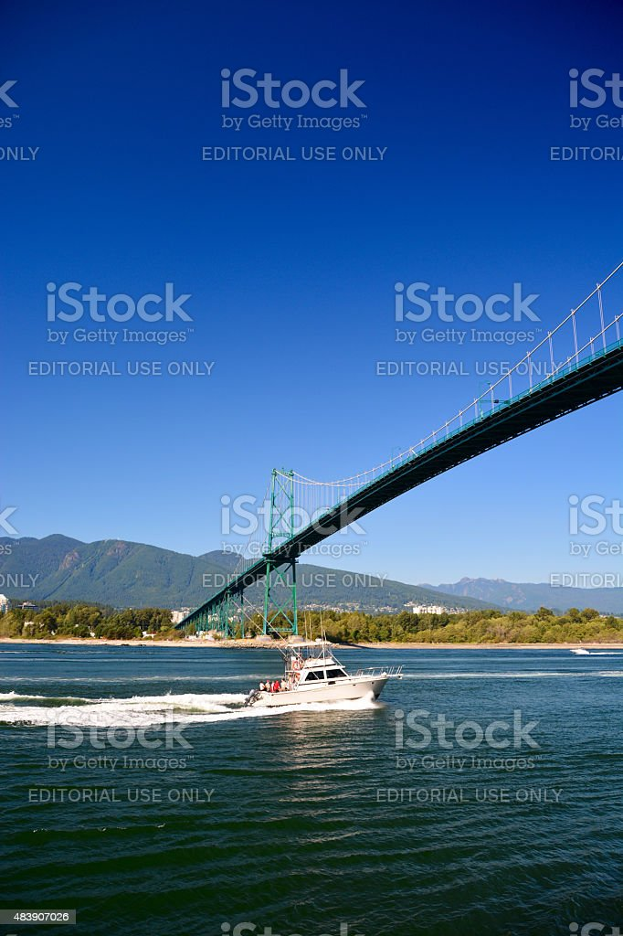 Fishing boat passing bridge in Vancouver stock photo