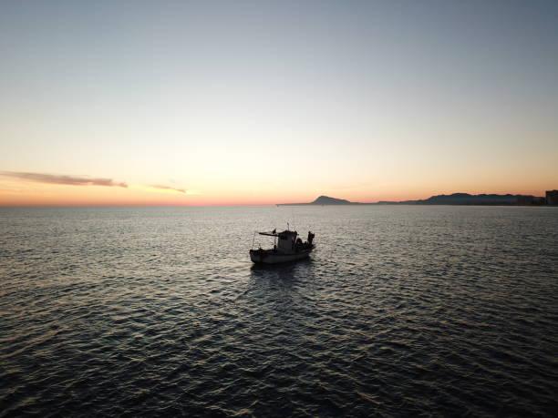 Pesca en bote - foto de stock