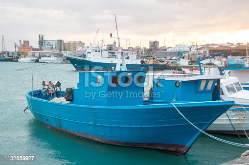 A small fishing boat in the harbor of Catania, in Sicily, Italy.