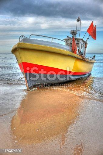 932662672istockphoto HDR fishing boat 1170374529