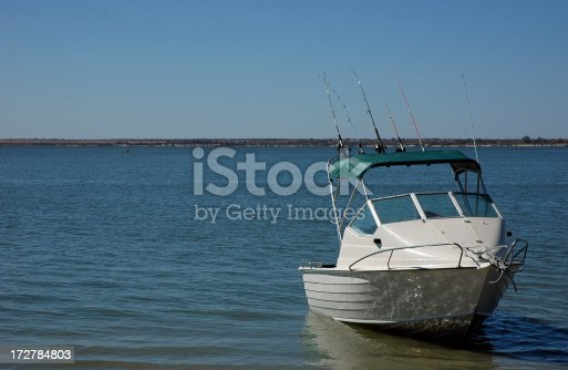 small fishing boat with fishing rods