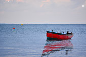 Simplicity style photograph of a fishing boat and calm seas.
