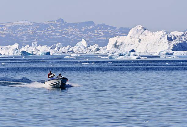 Fishing boat returning to harbour in Illulisat, Greenland stock photo