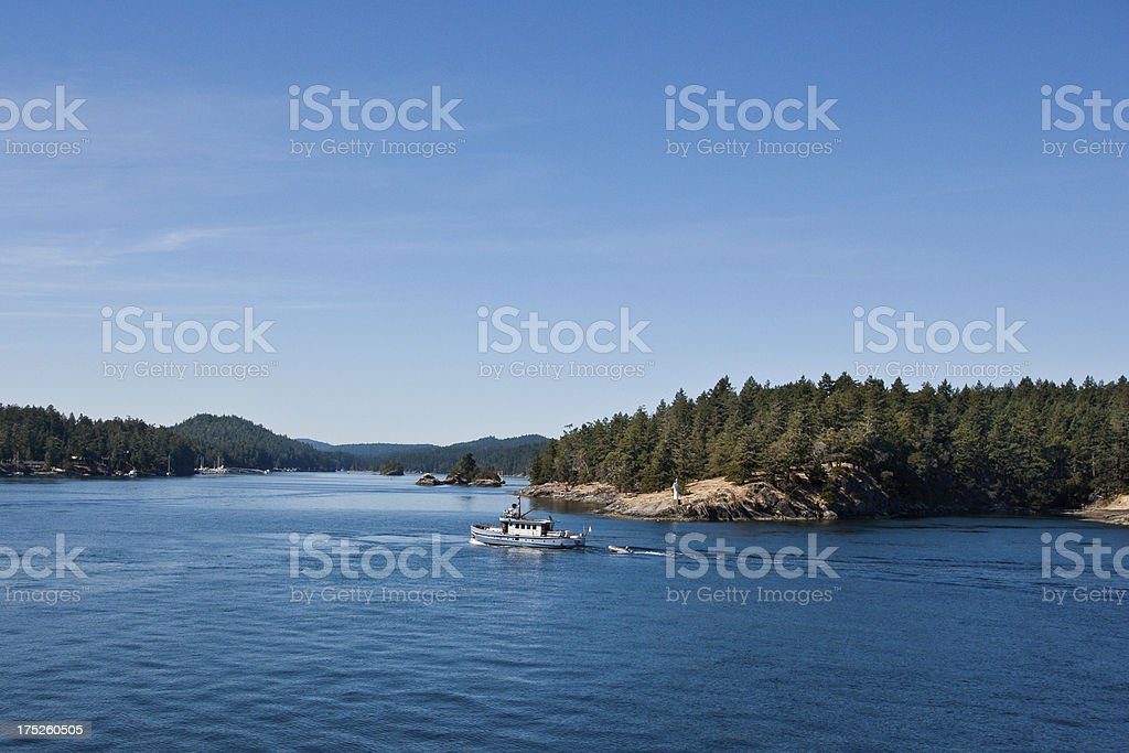 Fishing Boat Rounds Nose Point and Enters Long Harbor royalty-free stock photo