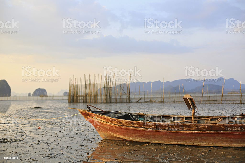 Fishing boat stranded on mud at low tide stock photo