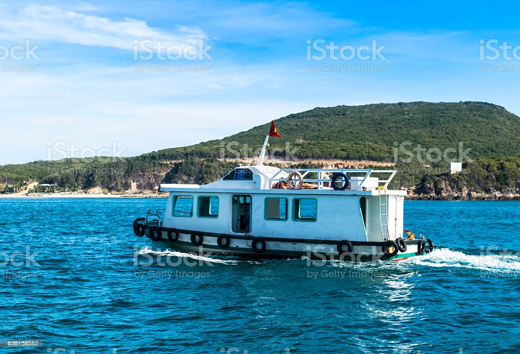 Fishing boat tin the blue ocean in the early morning royalty-free stock photo