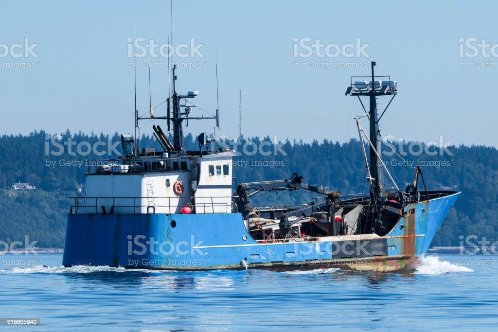 Fishing boat underway stock photo