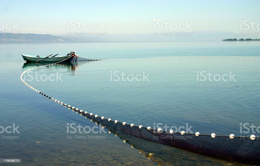 A fishing boat with its nets cast out stock photo