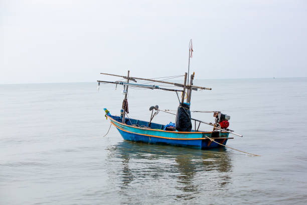 Fishing boat,Activity, Asia, Fishing, Lighthouse, Nautical Vessel stock photo