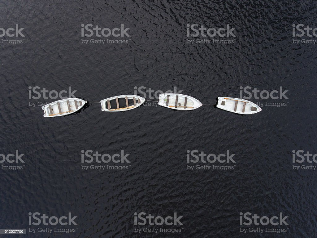 Fishing boats anchored on the lake, aerial photograph stock photo