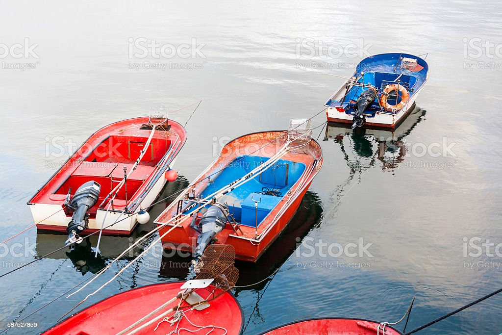Fishing boats anchored on the sea stock photo