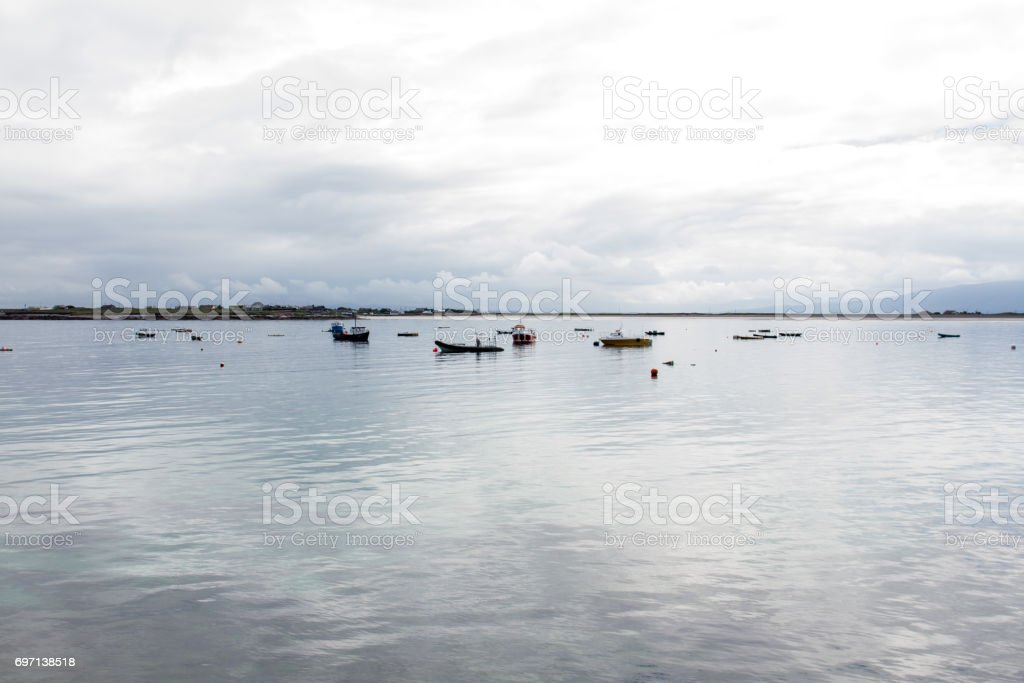 Fishing boats and a still sea 2 stock photo