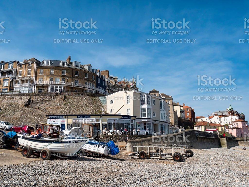 Fishing boats and Cromer promenade stock photo