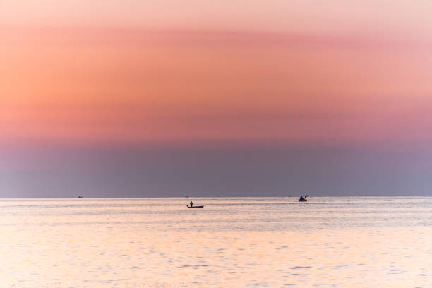 Fishing Boats and Sunset on the Mediterranean Sea - foto stock