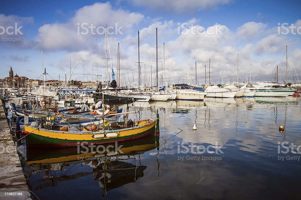 Fishing boats and yachts at the Harbor of Alghero, Sardinia stock photo