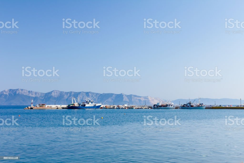 Fishing boats are tied up in the dock, marina stock photo