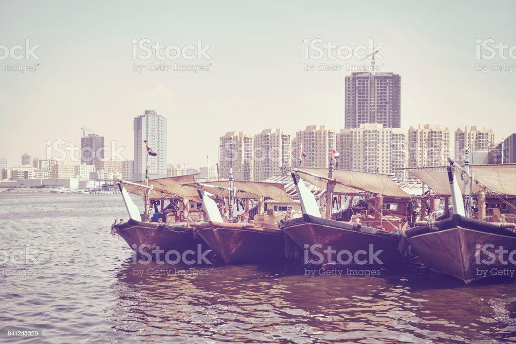 Fishing boats at Ajman fish market pier. stock photo