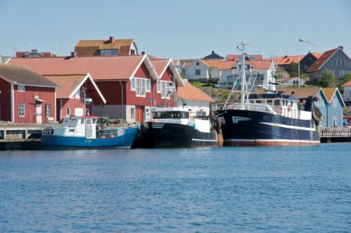 istock fishing boats at harbor 92478945