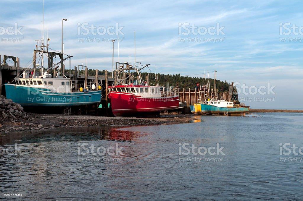 Fishing Boats at Low Tide at Bay of Fundy stock photo