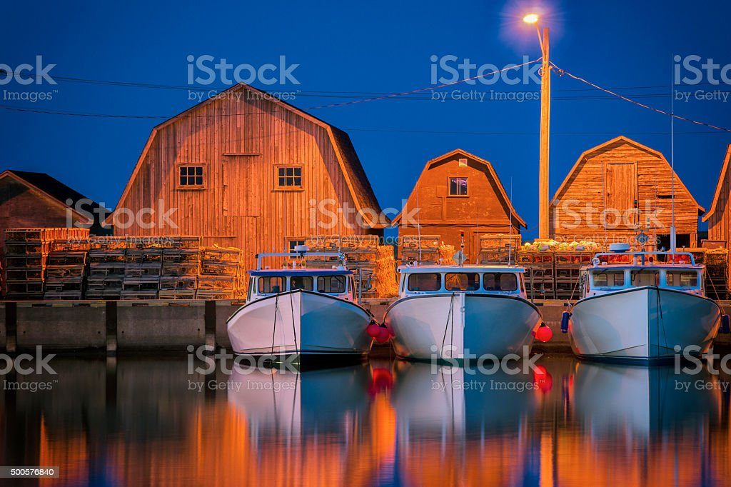 Fishing boats at Malpeque Harbour P.E.I. blue hour. stock photo