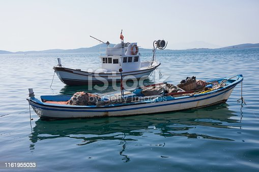 Blue fishing boats at sea
