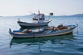 Blue fishing boats at sea