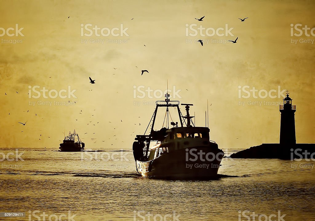 Fishing boats at Sunset stock photo