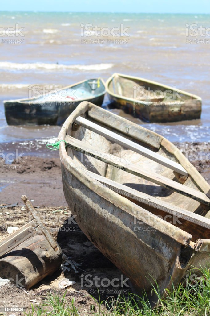 Fishing boats at the beach stock photo