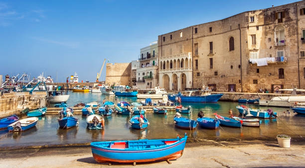 Fishing boats at the old port of Porto Vecchio in Monopoli Puglia Italy stock photo