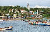 Kovalam, India - September 25, 2019: Fishing boats at Vizhinjam harbor, strategic and tourist location in Kovalam, Kerala, India