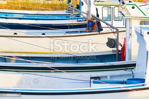 fishing boats side by side different colors
