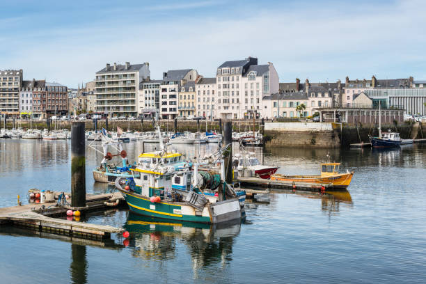 Fishing boats docked in Cherbourg-Octeville, Normandy, France Cherbourg-Octeville, France - May 22, 2017: Fishing boats docked in the port of Cherbourg-Octeville, on the north of the Cotentin peninsula, France. cherbourg stock pictures, royalty-free photos & images