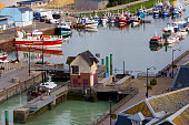 Small fishing boats back home in the harbor of Le Tréport, Normandy, France.
