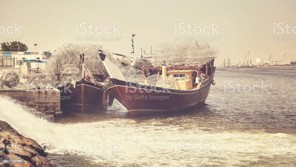 Fishing boats in Ajman harbor. stock photo