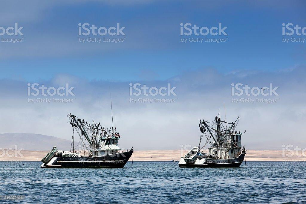 fishing boats in bay stock photo