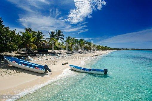 two fishing boats in Catalina island beach, a desert island near Punta Cana , Dominican Republic.