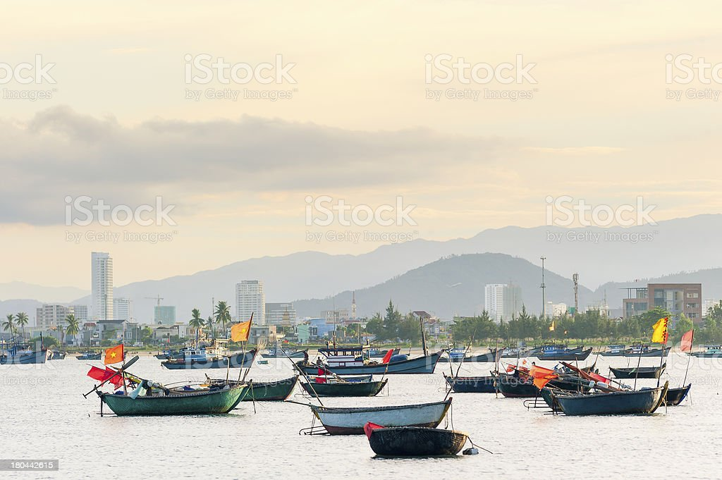 Fishing boats in Da Nang with the city at background royalty-free stock photo
