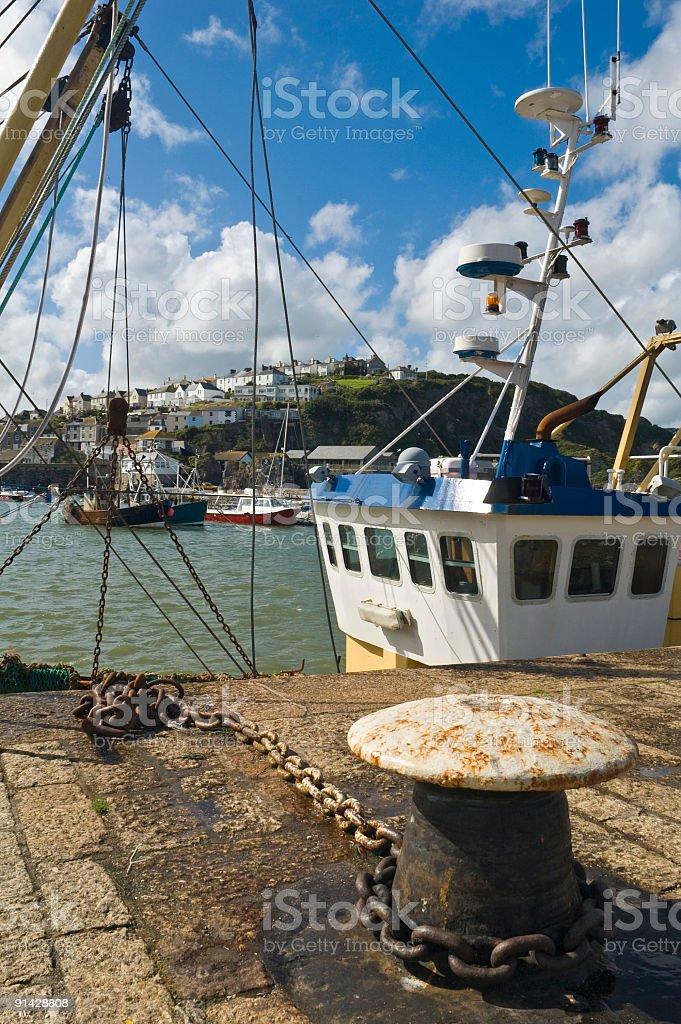 Fishing boats in harbor royalty-free stock photo