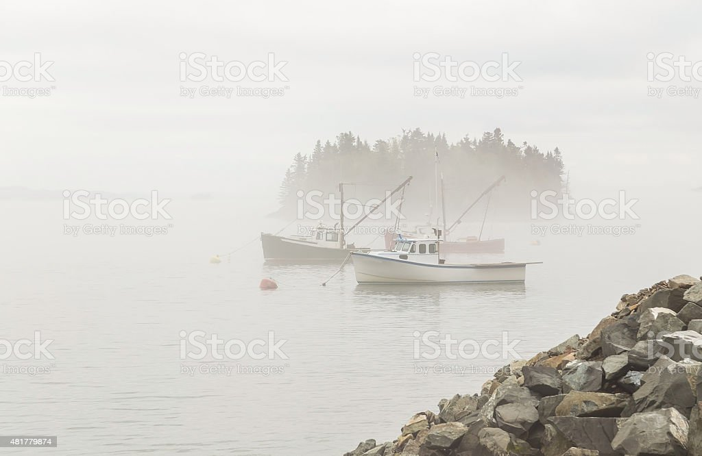 Fishing Boats in Heavy Fog stock photo