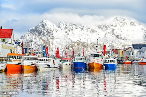 Fishing boats in the harbour of Henningsvaer a fishing village located on several small islands off the southern coast of Austvagoya in the Lofoten archipelago in Norway.