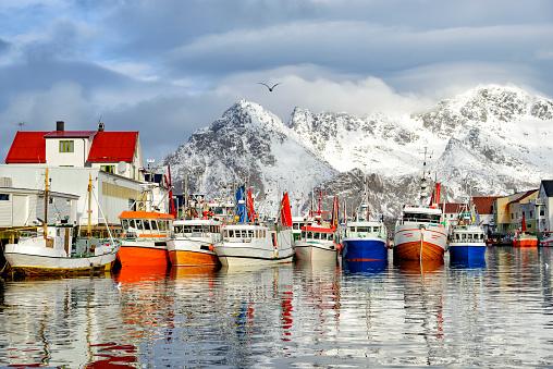 Fishing boats in Henningsvaer in winter in the Lofoten in Norway