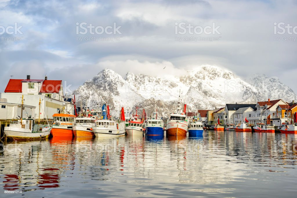 Fishing boats in Henningsvaer in winter in the Lofoten in Norway stock photo