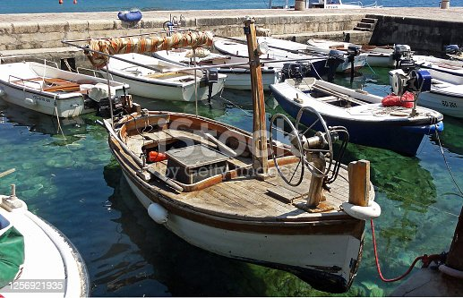 Wooden boat parked on the water