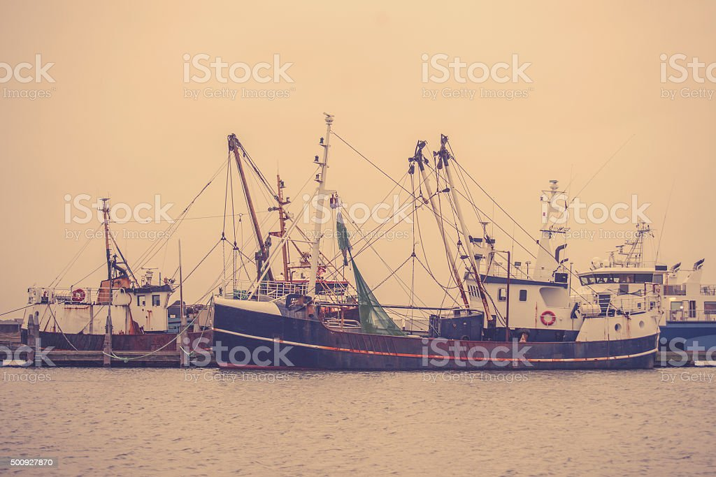 Fishing boats in the harbor stock photo